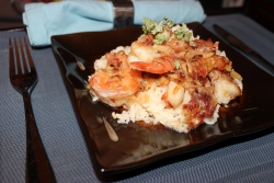 Serve scallops and shrimp over the rice